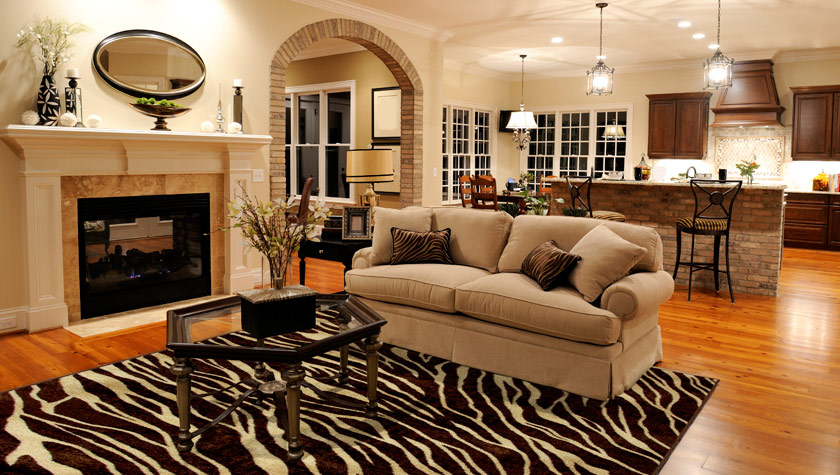decorate with area rugs aai flooring specialists. Black Bedroom Furniture Sets. Home Design Ideas